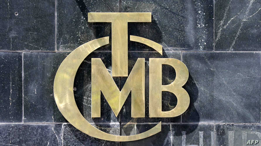 A picture taken on Aug. 14, 2018 shows the logo of Turkey's Central Bank (TCMB) at the entrance of the bank's headquarters in Ankara, Turkey