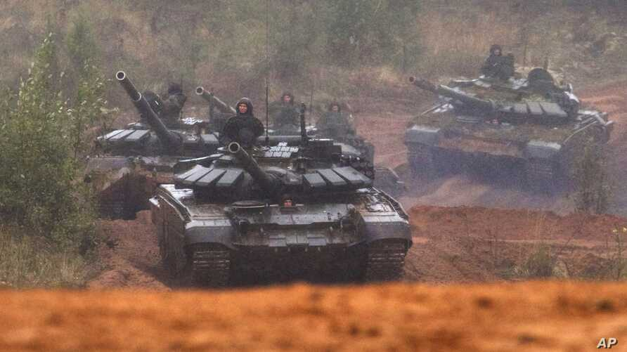 Russian tanks advance during the Zapad 2017 military exercises near St. Petersburg, Russia, Sept. 18, 2017.