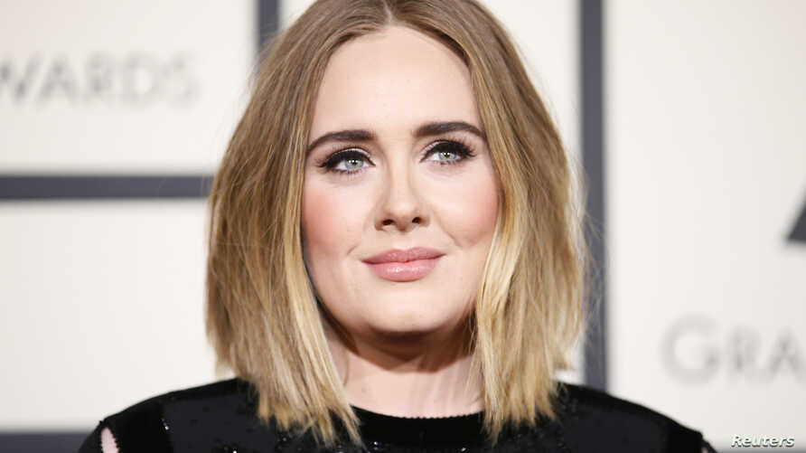 Singer Adele arrives at the 58th Grammy Awards in Los Angeles, California, Feb. 15, 2016.