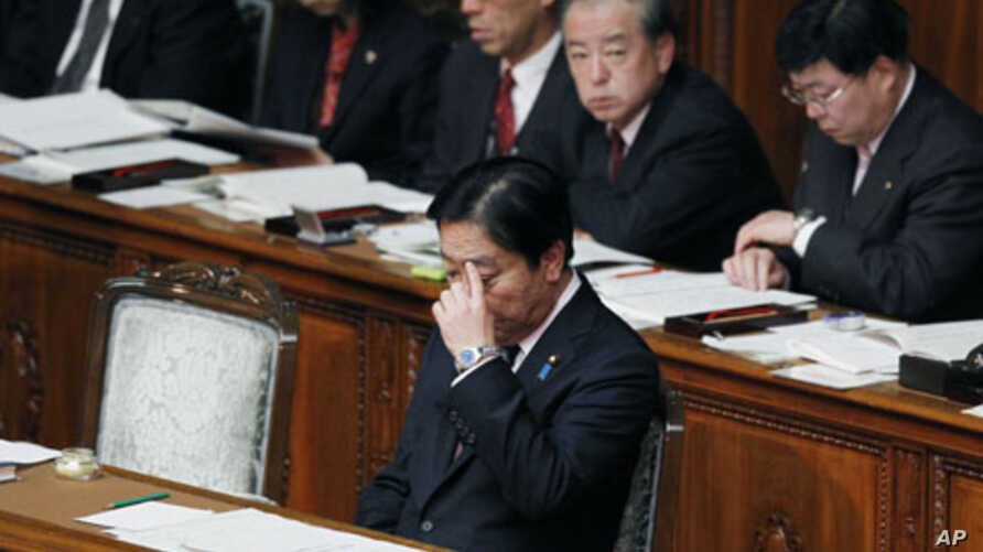 Japanese Prime Minister Yoshihiko Noda is seated after delivering his policy speech at the opening of the ordinary diet session at parliament in Tokyo, January 24, 2012.