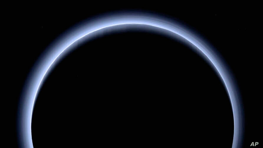 This image made available by NASA in March 2017 shows Pluto illuminated from behind by the sun as the New Horizons spacecraft travels away from it at a distance of about 120,000 miles (200,000 kilometers). On Friday, April 7, 2017, the spacecraft wil