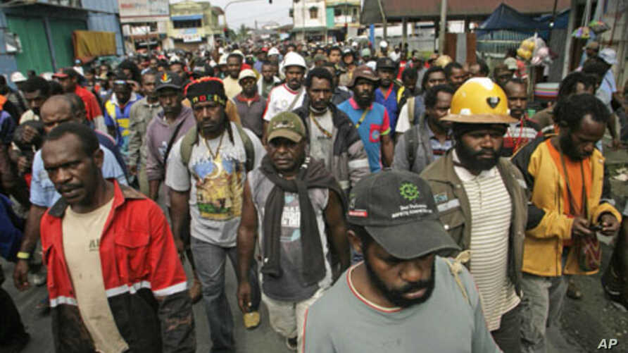 Protesters from Freeport-McMoRan Copper & Gold Inc.'s Grasberg mine march during a demonstration in Timika of Indonesia's Papua province, October 10, 2011.
