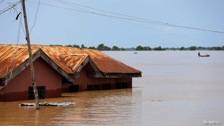 A house partially submerged in flood waters is pictured  in Lokoja city, Kogi State, Nigeria, Sept. 17, 2018.
