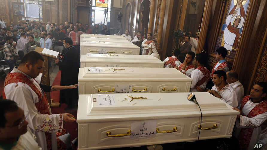 Coffins of the slain Coptic Christians are seen during their funeral service at Church of Great Martyr Prince Tadros, in Minya, Egypt,  Nov. 3, 2018.