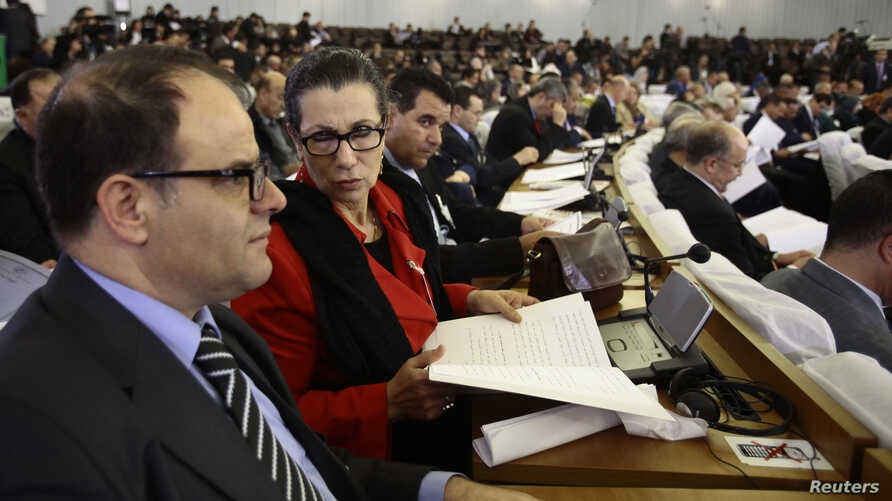 Louisa Hanoune, second left, Leader of Algeria's Workers' Party attends the constitutional reforms vote session in Algiers, Algeria, Feb. 7, 2016.