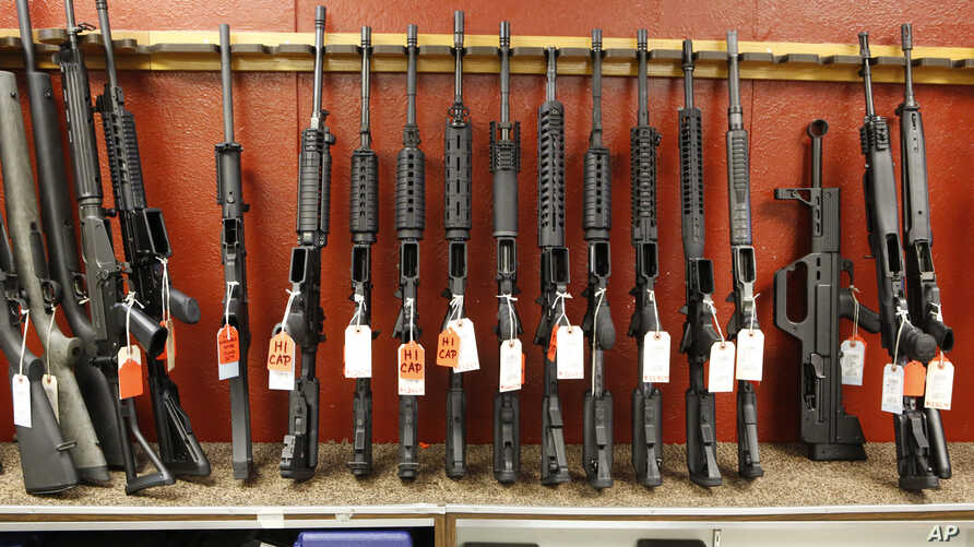 FILE - A rack of rifles is for sale at Firing-Line gun store in Aurora, Colo., June 27, 2013. A new poll conducted by The Associated Press-NORC Center for Public Affairs Research found that a majority of Americans favor stricter gun laws.