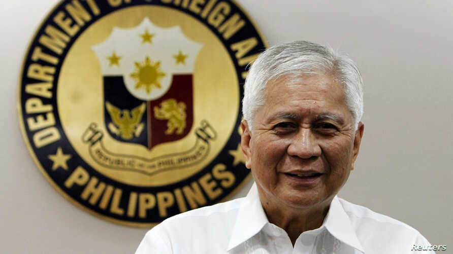 FILE - Philippine Foreign Affairs Secretary Albert Del Rosario at the Department of Foreign Affairs headquarters in Manila, Sept. 4, 2013.