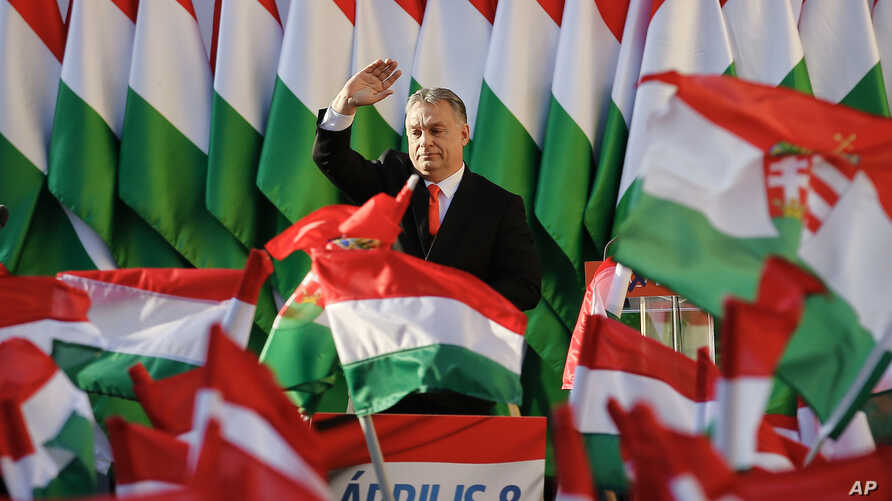 Prime Minister Viktor Orban's waves during the final electoral rally of his Fidesz party in Szekesfehervar, Hungary, April 6, 2018. Hungarians will vote Sunday in parliamentary elections, polls expect Orban to win a third consecutive term.
