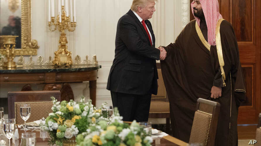 President Donald Trump shakes hands with Saudi Defense Minister and Deputy Crown Prince Mohammed bin Salman, in the State Dining Room of the White House in Washington, March 14, 2017.