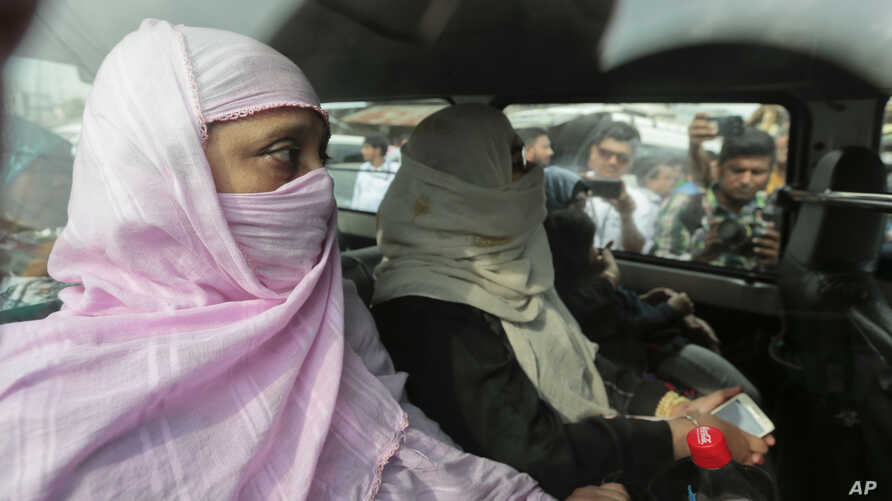 Relatives of Mir Quasem Ali, senior leader of the country's largest Islamic party Jamaat-e-Islami, arrive to meet Ali at the Kashimpur Central Jail in Gazipur, on the outskirts of Dhaka, Bangladesh, Saturday, Sept. 3, 2016.