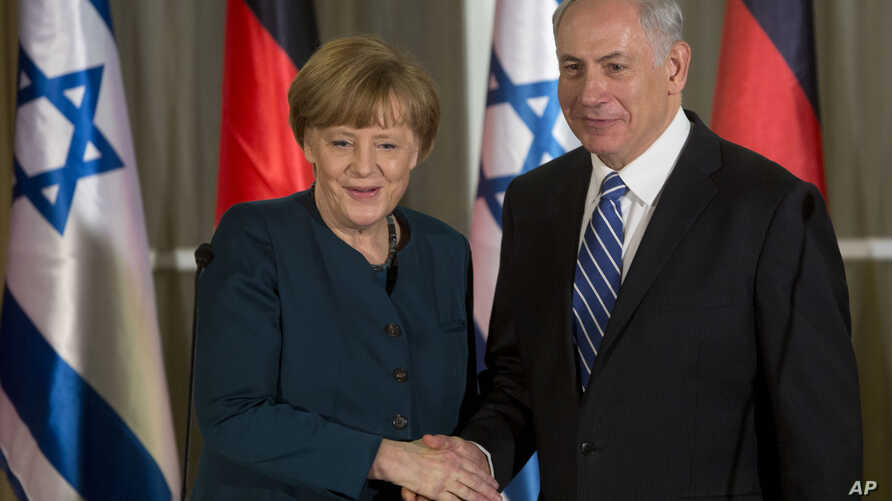 Germany's Chancellor Angela Merkel, left, shakes hands with Israeli Prime Minister Benjamin Netanyahu during their meeting at the Prime minister's residence in Jerusalem, Feb. 24, 2014.
