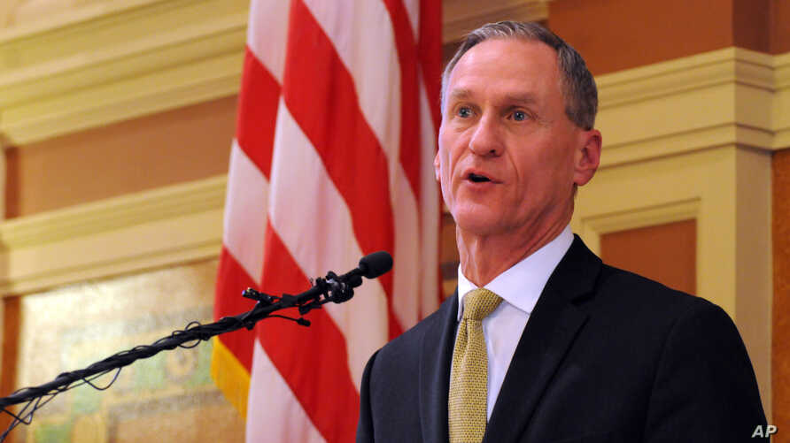 FILE - South Dakota Gov. Dennis delivers his during his State of the State address at the state Capitol in Pierre,. S.D., Jan. 12, 2016. He hasn't said if he will sign a bill approved by state lawmakers that would prohibit transgender students from u
