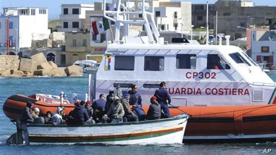 An Italian Coast Guard boat rescues a boat of refugees off Lampedusa, Italy, March 2, 2011