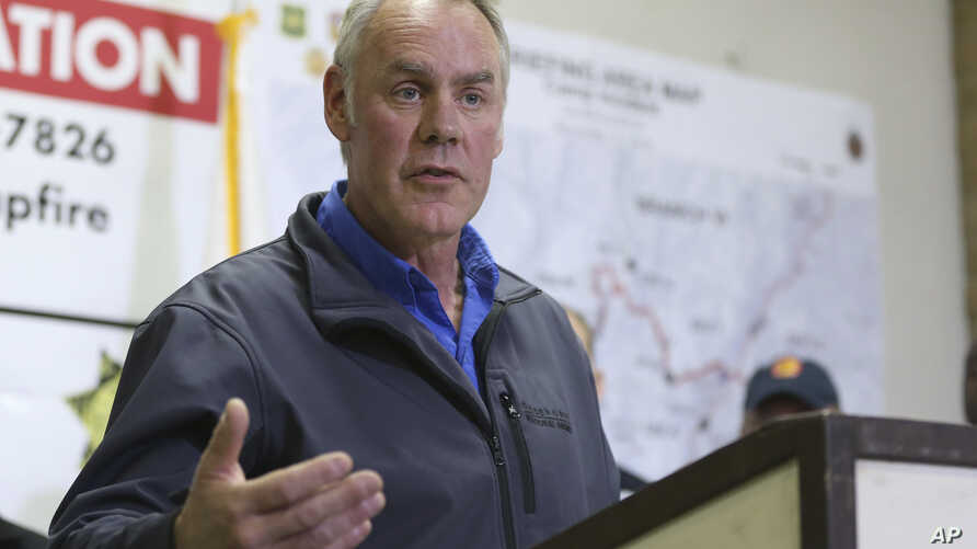 Ryan Zinke, Secretary of the Interior responds to a reporters question during a news conference after touring the fire ravaged town of Paradise, Calif., Nov. 14, 2018.