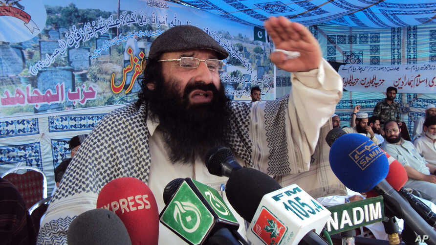 FILE - Syed Salahuddin, Supreme commander of Hizbul Mujahideen whose militants are fighting in Indian Kashmir against the Indian army, addresses his supporters in Muzaffarabad capital of Pakistan's administered Kashmir, July 13, 2011.