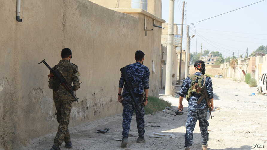 Syrian Democratic Forces patrol areas of Raqqa they controlled on Aug. 16, 2017.  As IS was defeated, the people fled.  Recaptured mid-October, the city is now nearly destroyed and entirely abandoned. (H.Murdock/VOA)