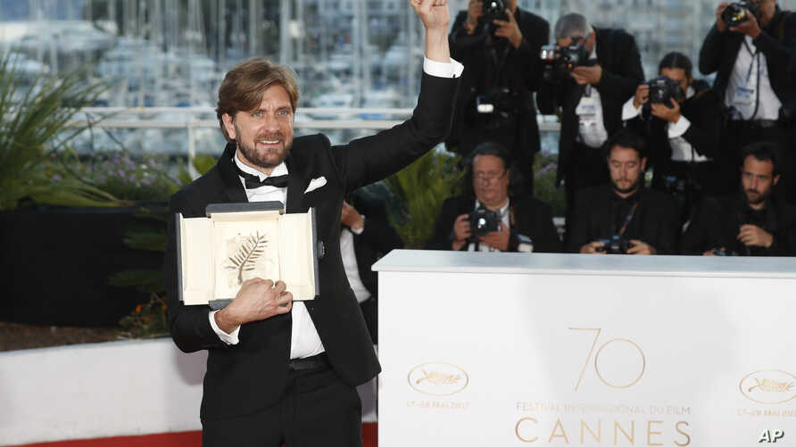 Director Ruben Ostlund with his Palme d'Or award for his film The Square poses for photographers during a photo call following the awards ceremony at the 70th international film festival, Cannes, France, May 28, 2017.
