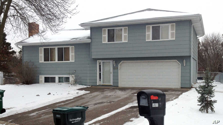 The home of Papa Faal in Brooklyn Center, Minn. Faal, 46, is one of two men in federal custody that prosecutors charged Monday with conspiring to help overthrow the government in the tiny West African nation of Gambia,  Jan. 5, 2015.