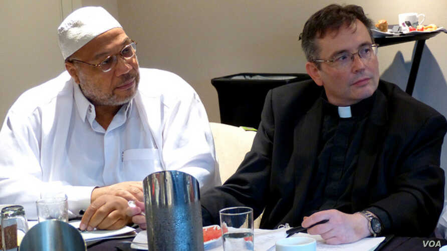 In this file photo, Imam Daayiee Abdullah and Reverend Dwayne Johnson discuss LGBT rights in the U.S. and reconciling those rights with religious beliefs.(Photo via Flickr user East-West Center via Creative Commons license)