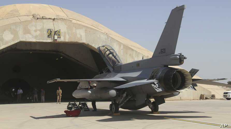 FILE - One of four new U.S.-made F-16 fighter jets outside a hardened hangar upon its arrival to Balad Air Base, north of Baghdad, Iraq, July 2015.Documents and interviews describe schemes at the air base that were major contract violations or illega