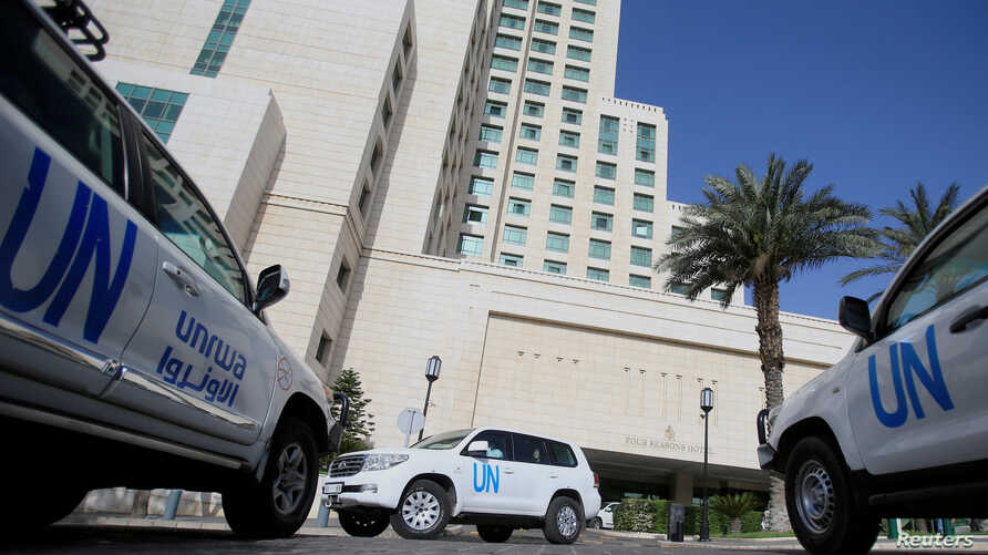 The United Nation vehicles carrying the Organisation for the Prohibition of Chemical Weapons (OPCW) inspectors is seen in Damascus, Syria, April 18, 2018.