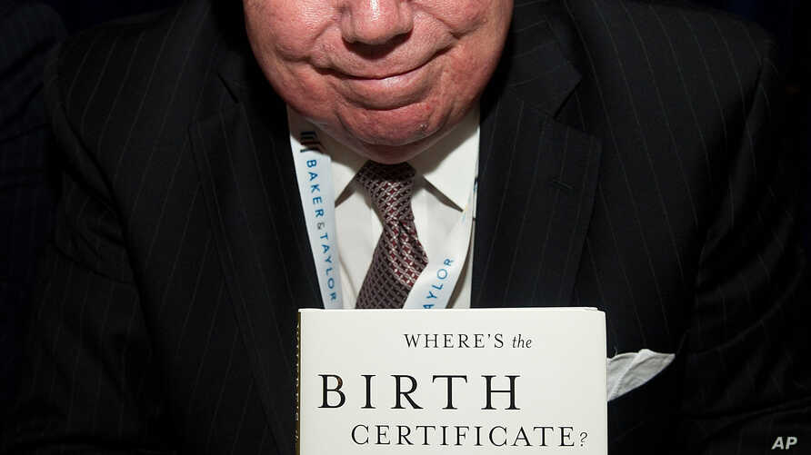 FILE - Jerome Corsi signs copies of his books at the Book Expo America in New York, May 25, 2011.