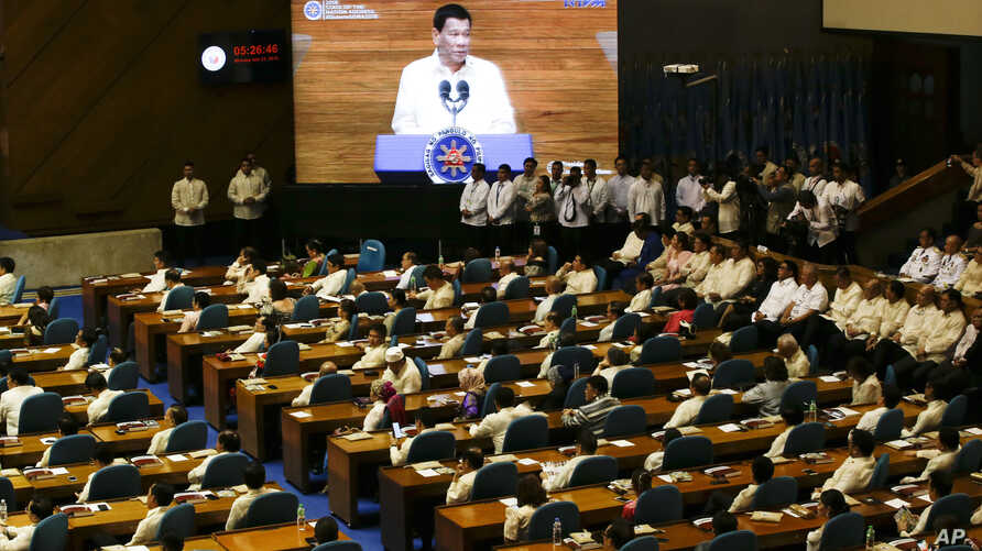 Philippine President Rodrigo Duterte is seen on a video screen during his third State of the Nation Address at the House of Representatives in Quezon city, metropolitan Manila, Philippines, July 23