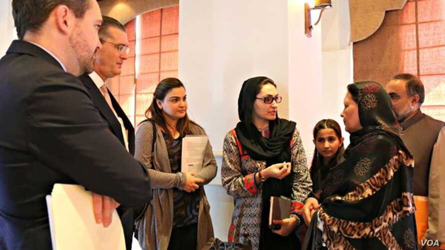Afghan refugee teacher, Aqeela Asifi, shares her perspective on the Refugee Affected and Hosting Areas Initiative with U.S. Ambassador to Pakistan, H.E Mr. Richard G. Olson and UNDP Country Director, Marc-André Franche, Aug. 28, 2015. (Photo: UNDP Pa