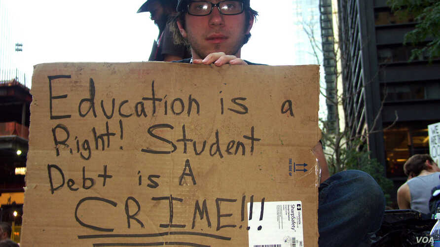 A college student voices his opinion on education and student debt in Zuccotti Park on the 23rd day of the Occupy Wall Street movement in New York City, 10/9/2011 – Photo by Phineas Azcuy