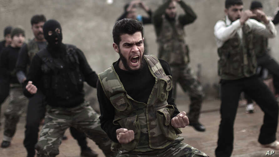 FILE - Syrian rebels attend a training session in Maaret Ikhwan near Idlib, Syria.