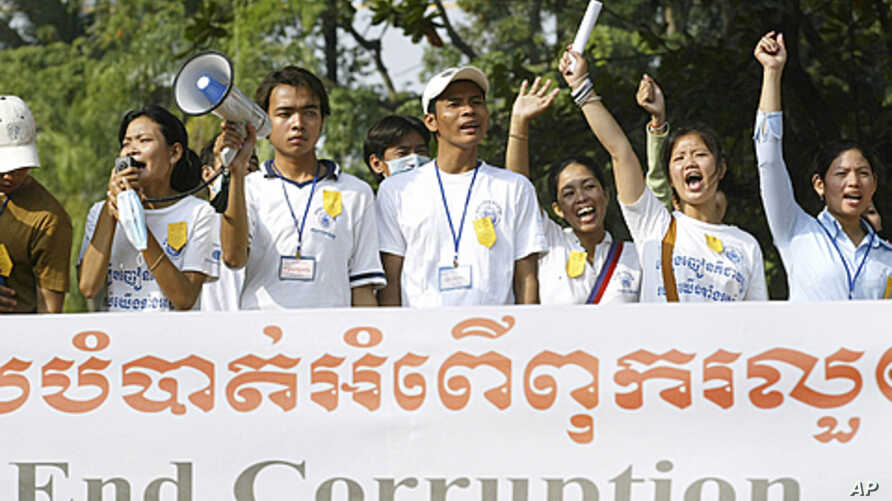 Cambodian non-governmental organizations workers shout slogans during a demonstration in Phnom Penh, Cambodia, 2004. Local aid workers marched through Phnom Penh to urge the donors to press Cambodia to remove restrictions on demonstrations, promote r