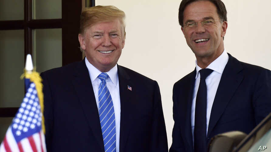 President Donald Trump, left, welcomes Dutch Prime Minister Mark Rutte, right, to the West Wing of the White House in Washington, July 2, 2018.