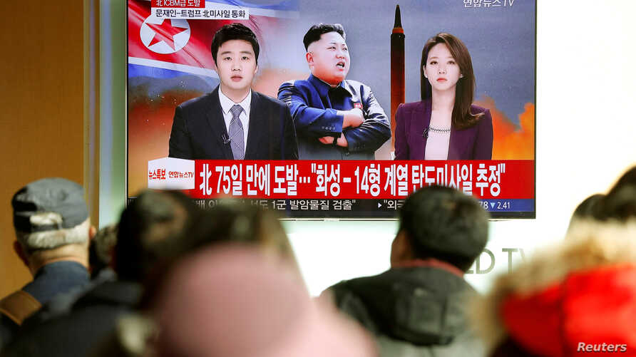 FILE - People watch a TV news report on North Korea, in Seoul, South Korea, Nov. 29, 2017.