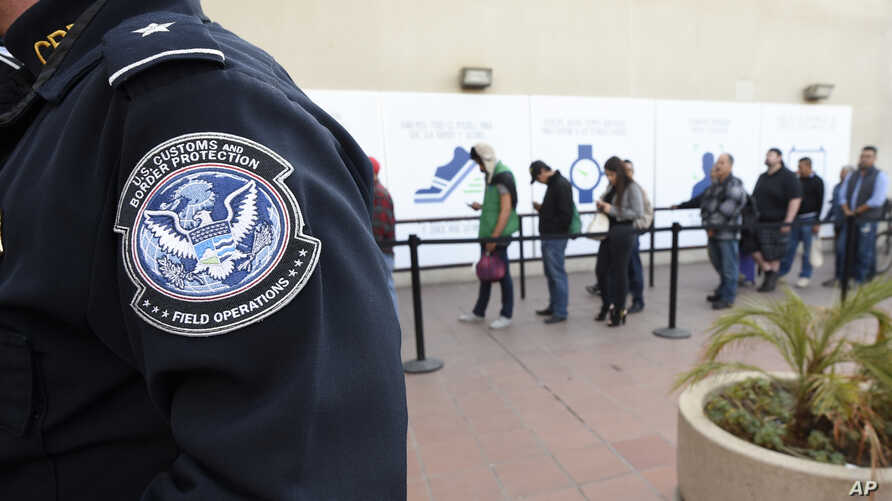 Pedestrians crossing from Mexico into the United States at the Otay Mesa Port of Entry wait in line, Dec. 10, 2015, in San Diego. U.S. Customs and Border Protection is now capturing biometric facial and eye scans of foreigners entering the country at