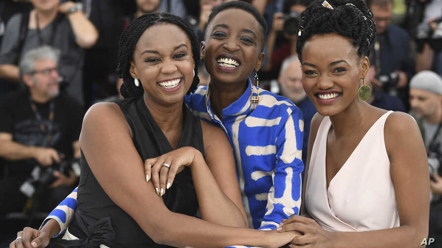 FILE - From left, director Wanuri Kahiu, actress Samantha Mugatsia and actress Sheila Munyiva pose for photographers during a photo call for the film 'Rafiki' at the 71st international film festival, Cannes, France, May 9, 2018.