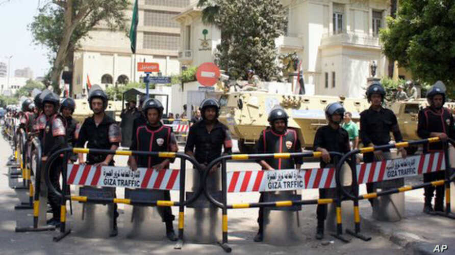 Security forces and tanks stand outside the now vacated Saudi embassy in Cairo, April 29 2012.
