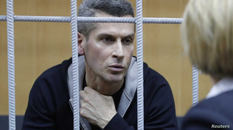 Ziyavudin Magomedov, the co-owner of Russia's Summa investment and trading group that was involved in construction of a soccer World Cup venue in Kaliningrad, talks with a lawyer during a hearing on his detention at the Tverskoy District Court in Mos