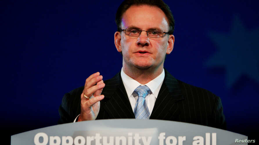 FILE - Australian opposition Labor leader Mark Latham makes a concession speech to the Labor party's election evening rally in Sydney, Oct. 9, 2004..