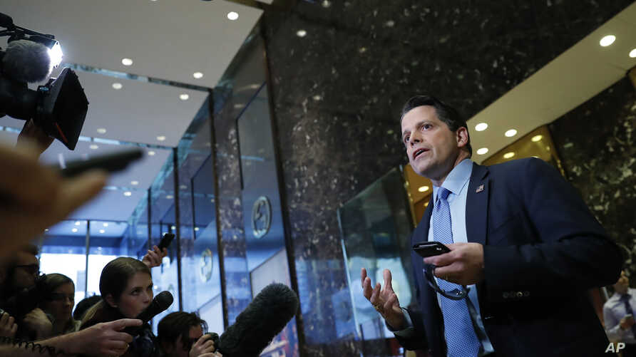 FILE - Anthony Scaramucci talks with media at Trump Tower in New York, Nov. 17, 2016.