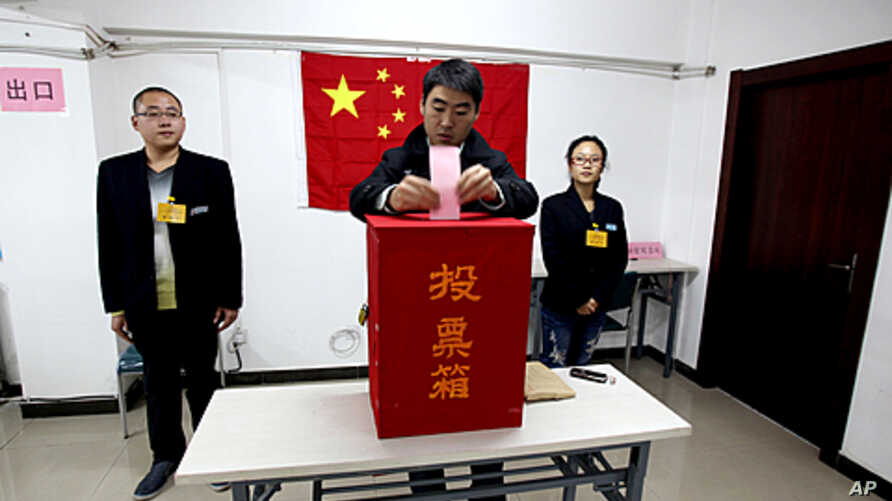 A Chinese man casts his vote during the local people's congress election in Beijing.  Most candidates are chosen by the government or Communist Party officials and while independents can take part if they have the backing of 10 people or more, few ha