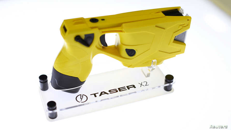 FILE - An X2 Taser gun is shown on display at the Taser booth during the International Association of Chiefs of Police conference in San Diego, California, Oct. 17, 2016.