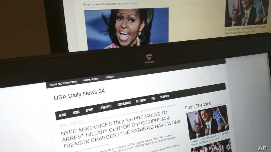 This photograph taken in Paris Friday Dec. 2, 2016 shows stories from USA Daily News 24, a fake news site registered in Veles, Macedonia. An Associated Press analysis using web intelligence service  Domain Tools shows that USA Daily News 24 is one of