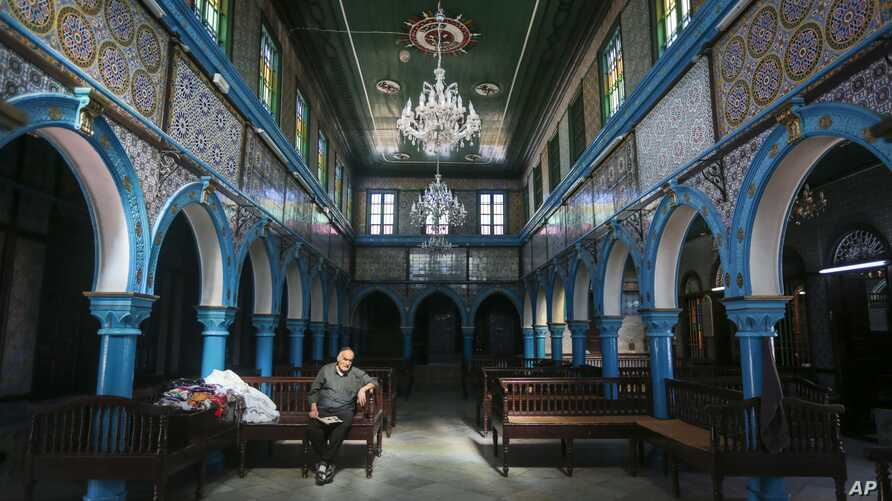 A Jewish Tunisian rests inside the Ghriba synagogue, one the oldest Jewish monuments built in Africa more than 2,500 years ago, on the resort island of Djerba, south of Tunis, Oct. 28, 2015.