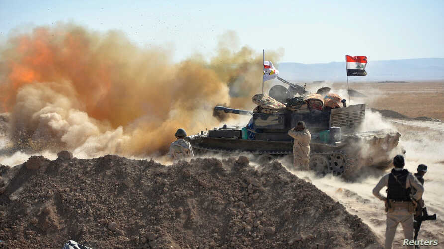 Iraqi army fire against Islamic State militants on the outskirts of Tal Afar, Iraq, August 20, 2017.
