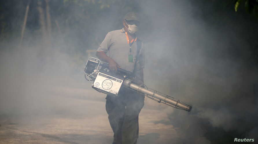 """A worker sprays insecticide for mosquitos at a village in Bangkok, Thailand, Jan. 13, 2016. Tropical Southeast Asian countries said they were bracing for the Zika virus, with Malaysia saying it could """"spread quickly"""" if introduced. Thailand had just"""