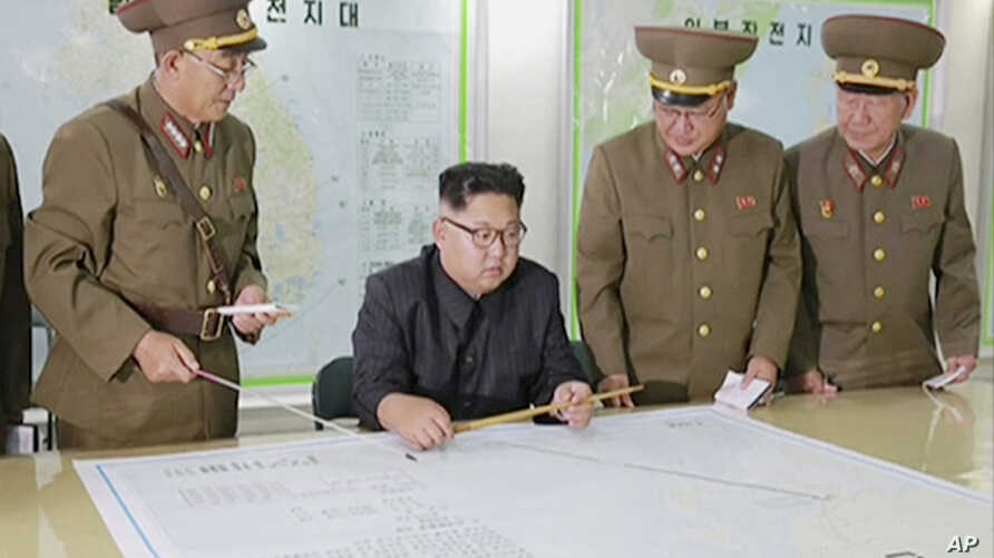 This image made from video of an Aug. 14, 2017, still image broadcast in a news bulletin, Aug. 15, 2017, by North Korea's KRT shows North Korean leader Kim Jong Un receiving a briefing in Pyongyang.