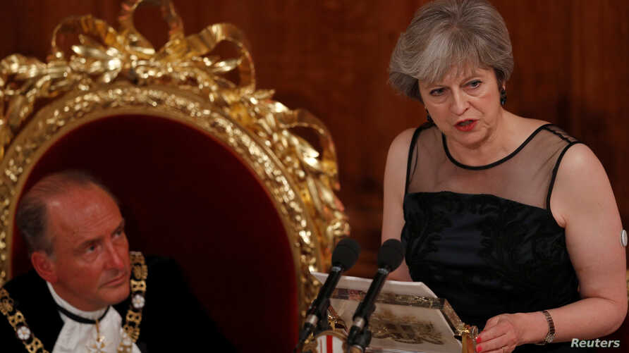 FILE - Britain's Prime Minister Theresa May speaks at the Lord Mayor's Banquet at the Guildhall, in London, Britain, Nov. 13, 2017.