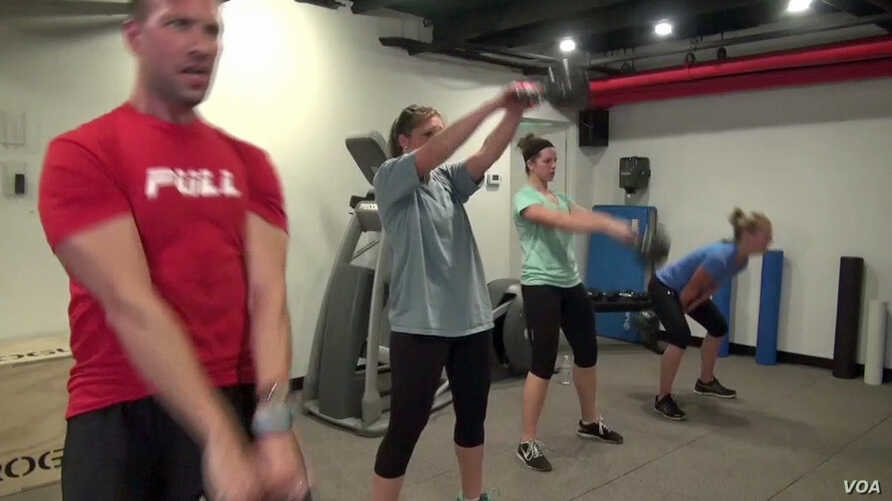 Exercisers at the Roam Fitness gym in downtown Washington