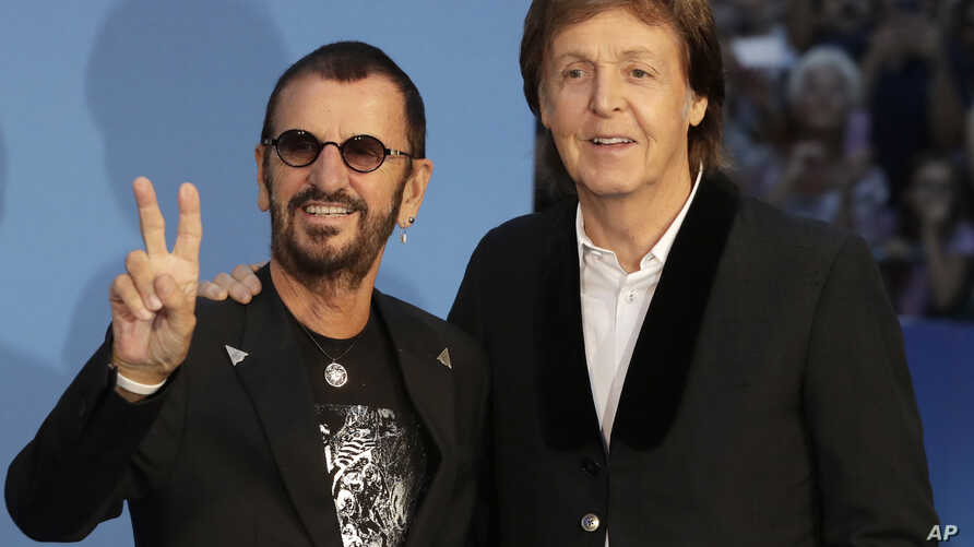 Musicians and members of the Beatles, Paul McCartney, right, and Ringo Starr pose for photographers upon arrival at the World premiere of the Beatles movie, Ron Howard's 'Eight days a week-the touring years' in London, Thursday, Sept. 15, 2016.