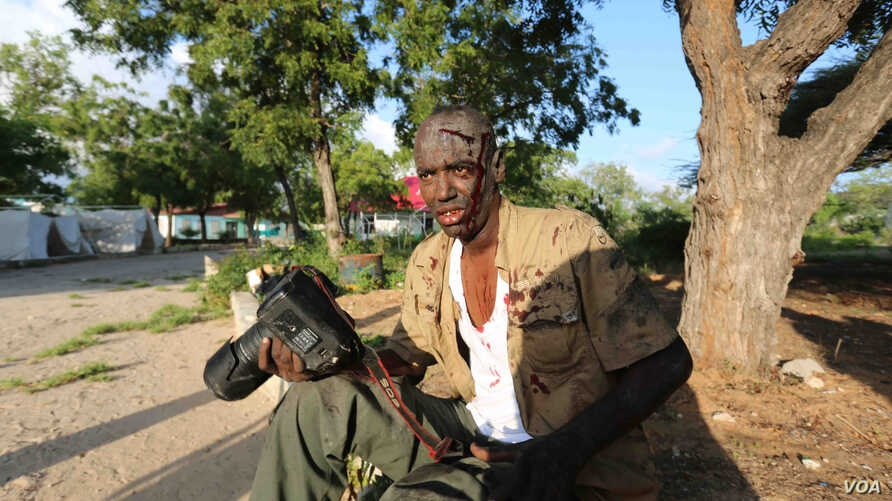 Feisal Omar, a photographer for the Reuters news agency, has been injured while covering a dangerous situation in Somali.